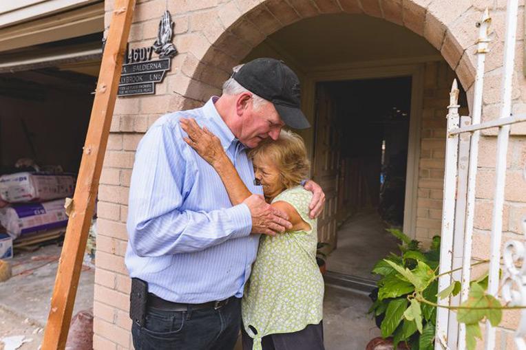 Franklin Graham met many Houston homeowners, like Margarita Cruz Saldierna, who were heartbroken by devastating losses.