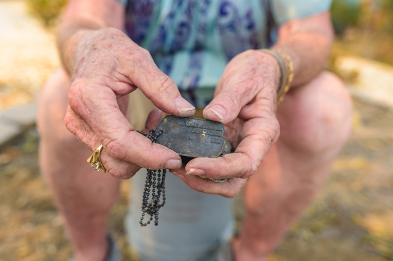 These dog tags are a cherished keepsake volunteers found buried in ash alongside other valuables.