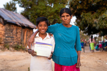 Eusebia, one of the first believers in Jesus Christ in her village, and her grandson Jonathan celebrate his graduation from The Greatest Journey. Jonathan gave his heart to Christ during an Operation Christmas Child Gospel presentation at the village.