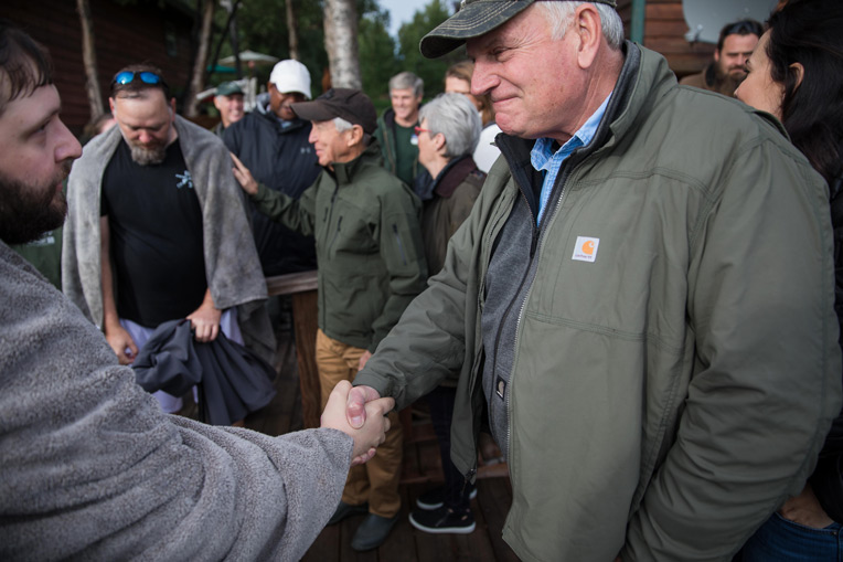 Franklin Graham greets veterans and spouses after their baptism in Lake Clark at the end of week 14 at Samaritan Lodge.