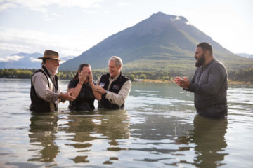 Army Sergeant First Class Jose Garza applauds his wife Angelica after her baptism in Lake Clark. The Garzas both received Jesus Christ as Lord and Savior last week. They also recommitted their marriage to God and were baptized.