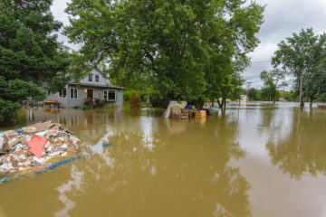 Debris was cleared out of a home in Reedsburg one week ago due to flooding. Now, it sits in water from a second flood.