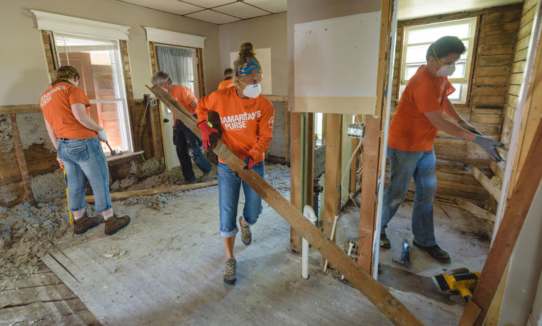 Samaritan's Purse volunteers remove waterlogged walls and floors after south central Wisconsin was inundated with widespread flooding.