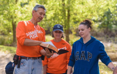 Site Team Leaders Henry and Mary Kook present Amber Schell with a Bible signed by all the volunteers who worked on her home.