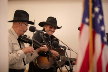 Dennis Agajanian and his brother Danny perform some tunes at the church dedication.