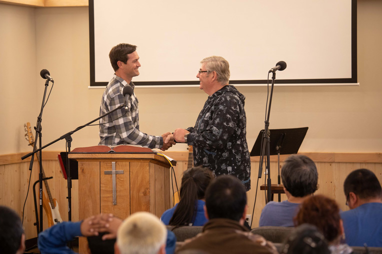Corey Lynch, left, is director of Alaska projects for Samaritan's Purse. Corey hands over the church's keys to Pastor Murchison.
