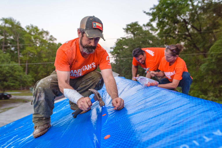 Samaritan's Purse volunteers helped patch roofs where high winds ripped up homes as Hurricane Florence churned through the Carolinas.