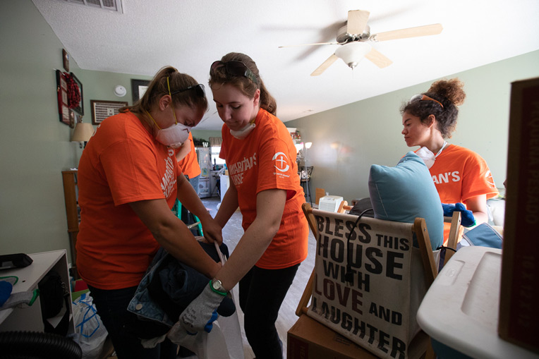 Liberty University students serving with Samaritan's Purse helped Briton salvage belongings and clean up the mess in her Jacksonville home.