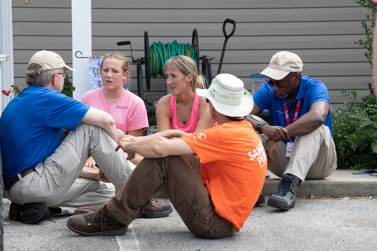 Homeowner Briton Wertz and her daughter Mia talk about Jesus with Samaritan's Purse volunteers and Billy Graham Rapid Response Team chaplains. Briton trusted Jesus as her Lord and Savior.