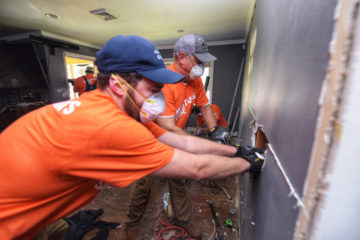 Lt. Governor Dan Forest and his son Jake tear out waterlogged dry wall.