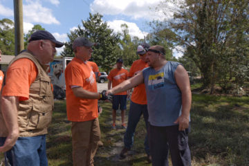North Carolina Lt. Governor Dan Forest meets homeowner Jovi Warner whose home was flooded as Hurricane Florence passed through.
