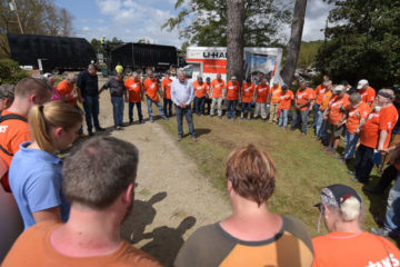 Samaritan's Purse President Franklin Graham prays with a large group of volunteers in New Bern.