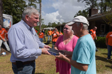 Franklin Graham presented a signed Bible to homeowners Bill and Charlene White.