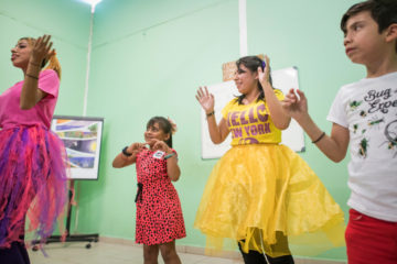 Jazmin and fellow members of her church praise team lead music during an Operation Christmas Child outreach event at one of the church's feeding centers where they teach little ones about Jesus.