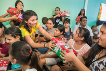 Jazmin helps distribute Operation Christmas Child shoebox gifts to girls in the 10 to 14-year-old age group.