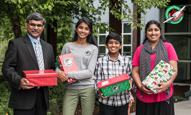 Raja, Giftlin, Jonathan, and Ramya delight in packing shoeboxes now to bless others the way they had been blessed.
