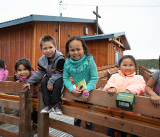 Children gather in front of Mountain Village Covenant Church in Mountain Village, Alaska. Everyone is celebrating the brand new church building constructed by Samaritan's Purse volunteers.