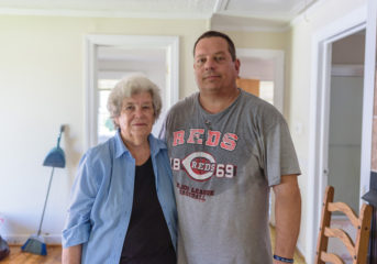 John and Love weathered the hurricane in Love's house where flood waters rose several feet.