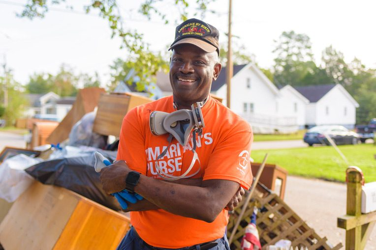 "Turner C. ""TC"" Bond was among eight military veterans from the Fleet Readiness Center East at Cherry Point who needed respirators to mud-out a New Bern home."