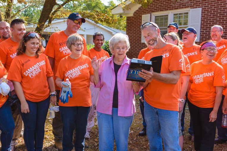 Love Whitfield was delighted when volunteers gave her a Bible signed by the team after completing work on her house.