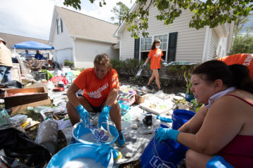 Volunteers clean dishes at the Hubbard's home.