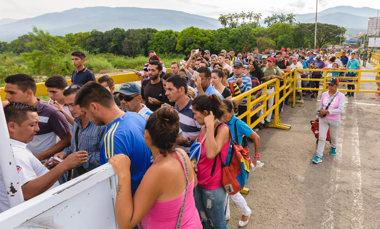 People waiting to enter Colombia on the Simon Bolivar International Bridge in Cucuta.