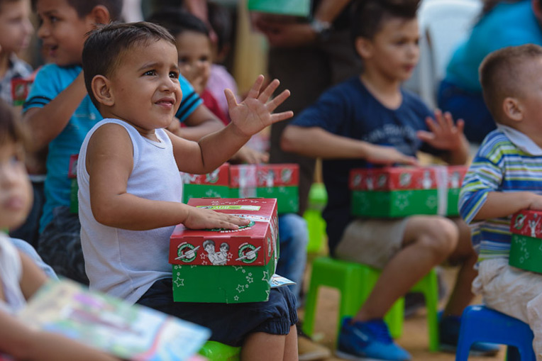 Yariana's nephew gets ready to open his shoebox gift.