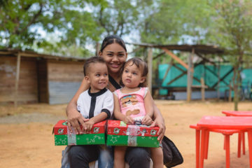 Kerigmar's two children were glad to get gift-filled shoeboxes this October. They are among thousands of Venezuelan children in Colombia due to the economic crisis in their homeland.