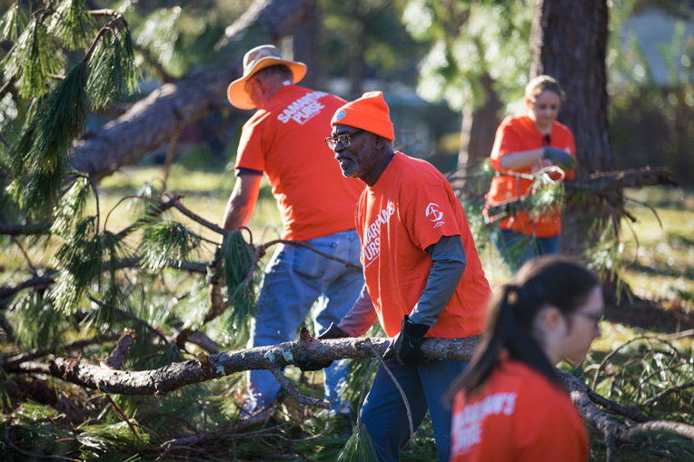Volunteer teams started clearing debris from yards and homes throughout Albany, Georgia.