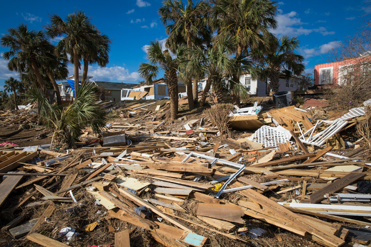 Timber where homes once stood tells the widespread story of damage throughout the Florida Panhandle.