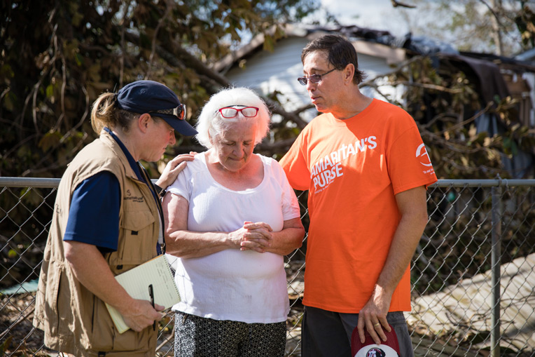 Assessors pray with a homeowner in the Florida Panhandle where our teams are beginning recovery efforts this week.