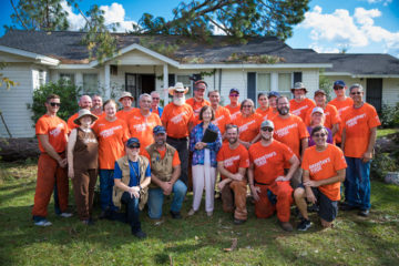 Vera Rozier stands with the Samaritan's Purse volunteers who helped clean up her yard and house.