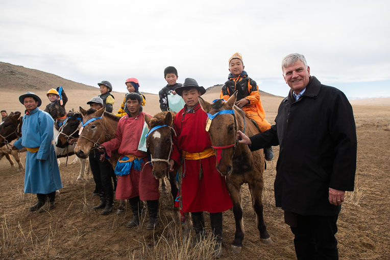 Franklin Graham and the children who participated in a horse race across the Mongolian grasslands.