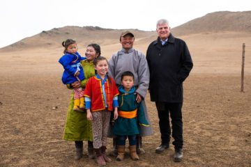 Franklin Graham meets in the grasslands of Mongolia's Tuv Province with the family of a Children's Heart Project beneficiary.