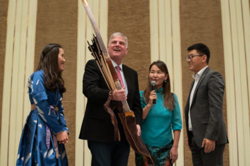 Franklin Graham is presented with a gift of Mongolian bow and arrows.