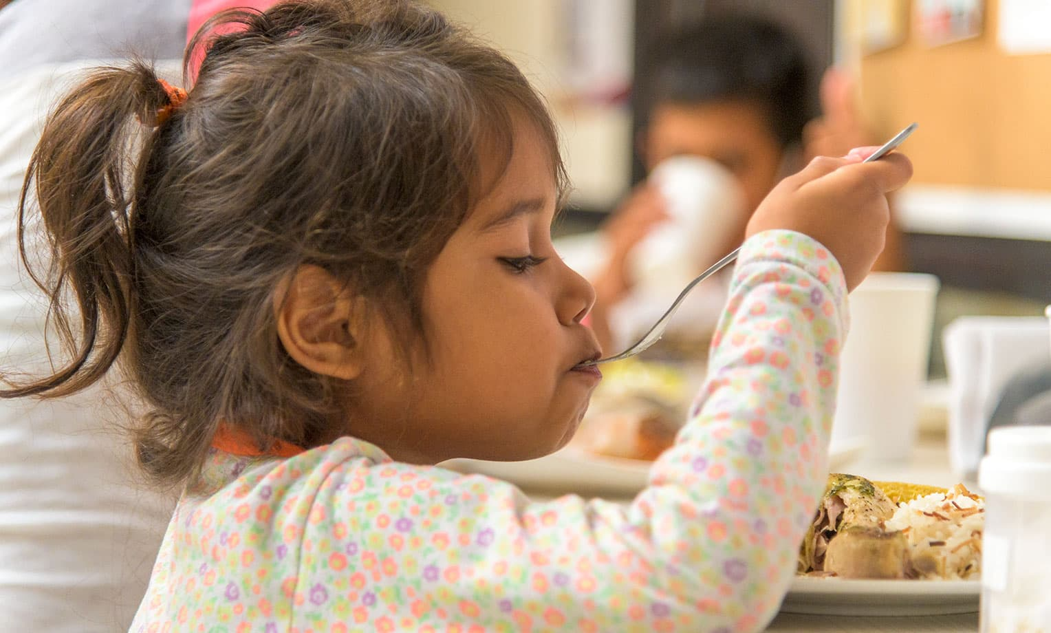 A young girl has a hearty meal at our shelter in Bucaramanga.