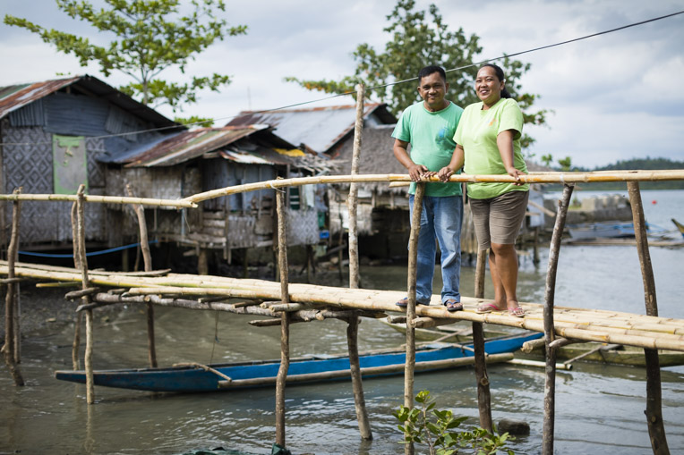 Couple in a fishing village in the Philippines