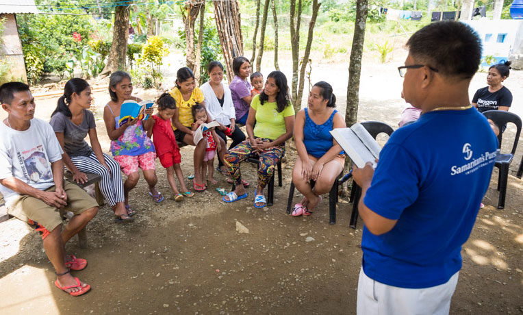 Members of a village in the Philippines gather for Bible study led by Marcelino Yongson. Marcelino and his wife Tess learned how to disciple believers and how to start small groups through a Samaritan's Purse training.