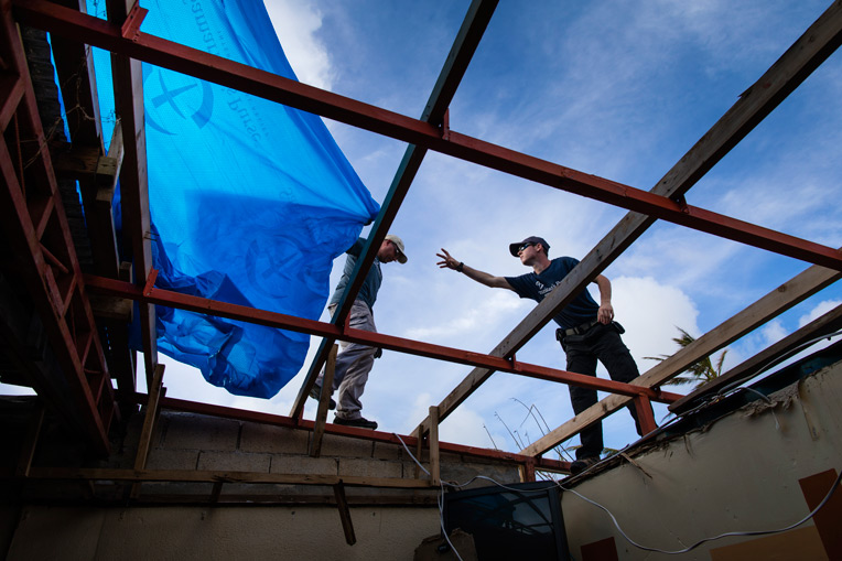 Our teams are helping tarp damaged homes to help protect families from the elements.