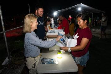 Greta Van Susteren participates in an evening distribution of tarps, generators, and water filters.