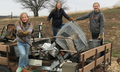 Naomi, Claira, and Hope Dannefer are blessing people in need by giving through the Samaritan's Purse gift catalog. Claira, right, collected and sold scrap metal to raise money for projects such as cleft lip and cataract surgeries, water filters, dairy goats, and blankets.