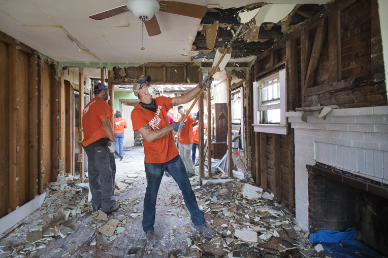 Samaritan's Purse volunteers work to remove a waterlogged ceiling from a home in Wilmington, North Carolina, that was hard-hit by Hurricane Florence.