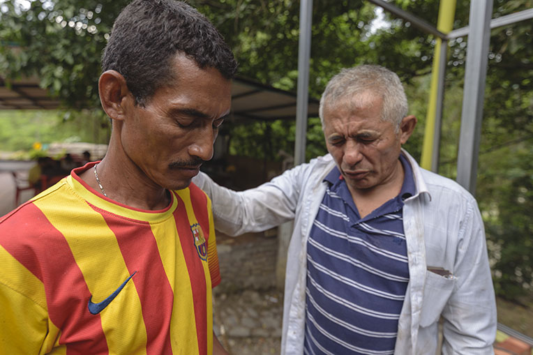 Teodoro, a welder at our shelter, prays with migrant Jose Luis Ochoa. Teodoro helped lead Jose to the Lord.