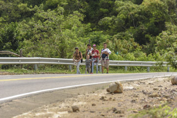 Migrant walkers are a common sight along the roads near Cucuta.