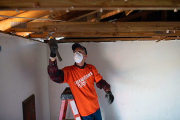 Volunteers are needed to do mud-outs, which sometimes include removing waterlogged ceilings.