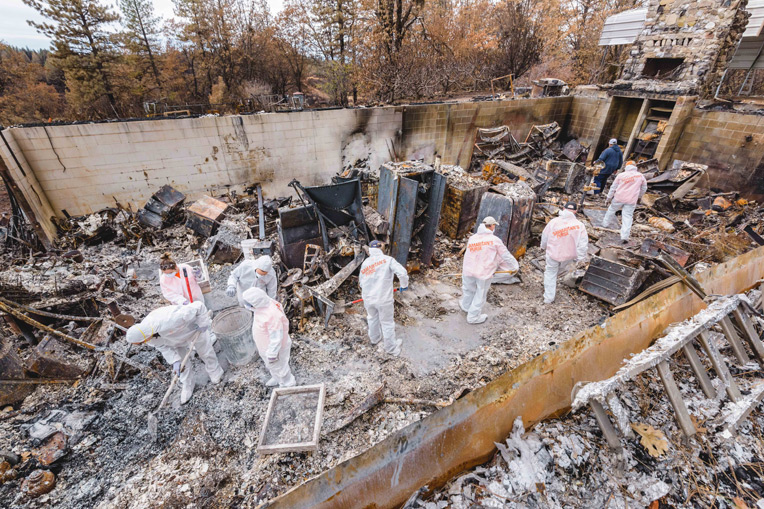 Samaritan's Purse volunteers sift through ashes at a residence in Butte County, California, where the deadly Camp Fire burned over 150,000 acres and more than 14,000 homes.