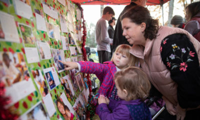Bake sale shoppers make a donation to the gift of their choice in the Samaritan's Purse Christmas catalog. The Buttles creatively display all 42 gift items on this large board.