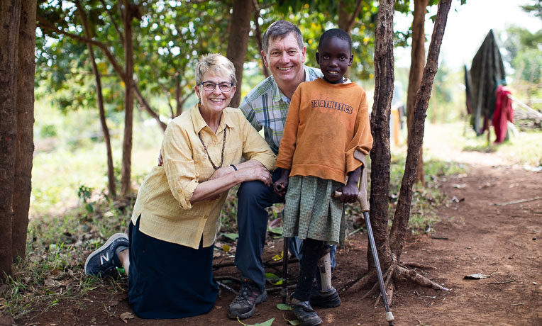Dr. Read Vaughan and his wife Suzie with a young girl named faith, one of many children they've helped through medical ministry.