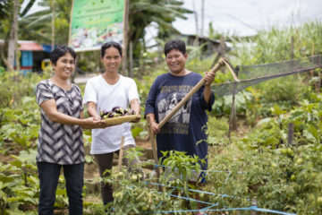 Rowena shares her faith with women in her community gardening group.