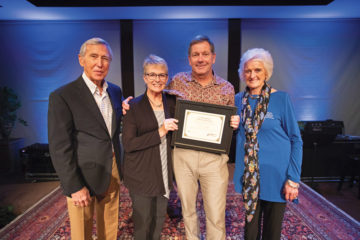 "Dr. Vaughan received the ""In the Footsteps of the Great Physician"" award from World Medical Mission representatives Dr. Richard Furman and Becky Williams. Vaughan and his wife Suzie have served with the ministry for over a decade."
